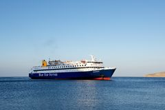 TILOS, GREECE - SEP 1: ferry arriving to small Tilos island, Greece on Sep 01, 2014. Big ferry coming to Tilos island in Aegean Se Royalty Free Stock Photography