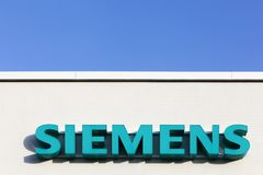 Siemens logo on a facade. Tilst, Denmark - February 14, 2016: Siemens logo on a facade. Siemens is a german multinational. The principal divisions of the company Stock Image