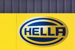Hella logo on a wall. Tilst, Denmark - May 10, 2018: Hella logo on a wall. Hella is an internationally operating German automotive part supplier with royalty free stock image