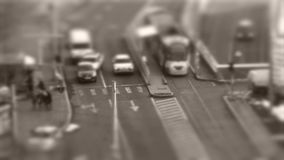 Tilt–shift cars in traffic, seen from above. Tilt–shift cars on the road, intersection, aerial view