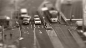 Tilt–shift cars in traffic, seen from above, timelapse. Tilt–shift cars on the road, intersection, aerial view, time-lapse stock video