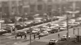 Tilt–shift cars in traffic, seen from above, timelapse. Tilt–shift cars on the road, intersection, aerial view, time-lapse stock footage