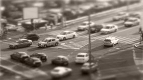 Tilt–shift cars in traffic. Tilt–shift cars on the road, intersection stock footage