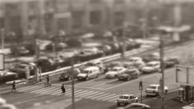 Tilt–shift cars in traffic, time-lapse. Tilt–shift cars on the road, intersection, timelapse stock video footage