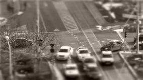 Tilt–shift cars in traffic, time-lapse. Tilt–shift cars on the road, intersection, timelapse