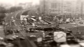Tilt–shift cars in traffic, seen from above. Tilt–shift cars on the road, intersection, aerial view stock video