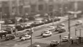 Tilt–shift cars in traffic, seen from above. Tilt–shift cars on the road, intersection, aerial view stock video footage