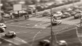 Tilt–shift cars in traffic, seen from above, timelapse. Tilt–shift cars on the road, intersection, aerial view, time-lapse stock video footage