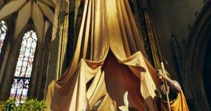 Tilt-down to nativity scene. THANN, FRANCE - CIRCA 2016: Nativity scene inside the Collegiale Saint-Thiebaut (Saint-Theobald collegiate church) in Thann, Haut stock video footage