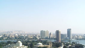 Tilt down to Opera House,Cairo skyline with Nile, Egypt stock footage
