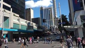 Tilt down - Traffic on Queen street in Auckland CBD New Zealand stock video footage