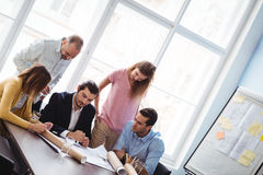 Tilt image of business people in meeting room Royalty Free Stock Images
