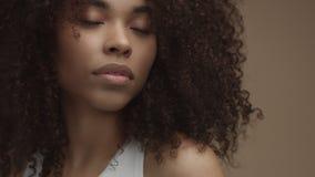 Tilt moving camera showing closeup portrait of mixed race black woman stock footage