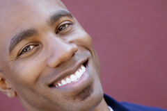 Tilt portrait of a happy African American man over colored background Royalty Free Stock Photos