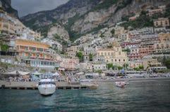 Tilt shif effect of Positano with people waiting to embark for the island of Capri. Amalfi coast, Italy stock image