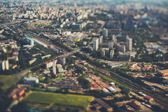 Tilt-shift aerial view of city railroad tracks from Royalty Free Stock Photos