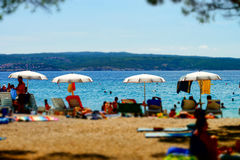 Tilt-shift beach view in warm weather on sea resort Stock Images