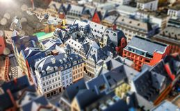 Tilt shift blur effect. Abstract cityscape with old architeture buildings. Frankfurt, Germany aerial view panorama with. Sunlight in the corner Royalty Free Stock Photos