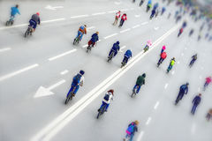 Tilt shift blur effect. Mass urban cycling marathon, back to us. Concept of Sport, healthy lifestyle, aktivity. Diagonal. Photo frame. Selective focus. For royalty free stock photo