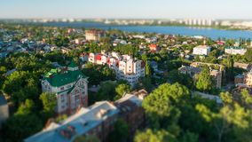 Tilt shift blurred city Voronezh, panoramic modern cityscape skyline in summer sunny day, aerial view.  stock photos