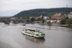 Tilt-Shift Boat. Boat in Vltava river with tilt shift lens effect Royalty Free Stock Image