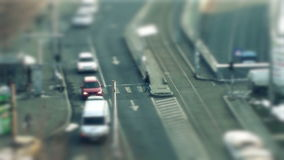 Tilt shift cars on the road. Traffic in the city, tilt shift and time lapse stock video footage