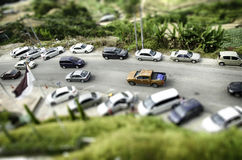 Tilt shift effect from aerial view, group of car park at garden Stock Photos