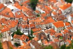 Tilt-shift effect of Kotor old town, Montenegro. Bird eye view of buildings in Kotor old town, Montenegro. Tilt-shift Miniature Effect Stock Photo