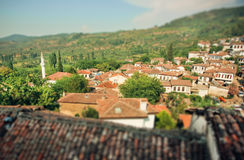 Tilt shift effect on the view of rural landscape with tiled roofs of Turkey Stock Images