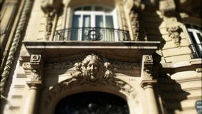 Tilt shift effect on a zoom out shot of an apartment in paris. Tilt shift effect applied to a zoom out shot of architectural detail on an apartment building in stock footage