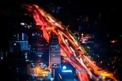 Tilt shift. Futuristic night cityscape. Bangkok, Thailand Royalty Free Stock Photos