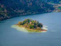 Tilt shift image of an island in the Schliersee lake in autumn. Tilt shift image of the island woerth in the Schliersee lake in autumn in bavaria Germany stock photos