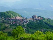 Tilt shift image of mountain village in italy stock photo