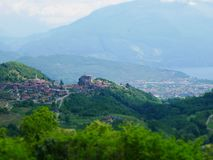 Tilt shift image of mountain village in italy royalty free stock photography
