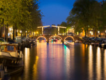 Tilt shift image of skinny bridge on canal in Amsterdam Stock Images