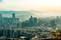 Tilt shift landscape of caracas during hazy, dark moody day with pollution, at sunset stock images