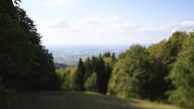 Kappelrodeck tilt-shift lens over the hills. Tilt-shift lens focusing over German landscape with green hills, lush forest and valley of Baden-Wurttemberg - as stock footage