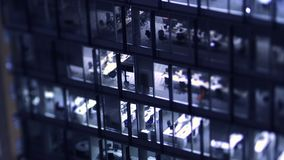 Tilt-shift lens over business skyscraper. Aerial helicopter view to skyscraper building in banking business district in worldwide hub with working late light stock video