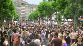 Tilt-shift lens over gay pride parade perspective. Strasbourg, France - Jun 10, 2017: Cinematic flare over tilt-shift lens used at LGBT gay pride parade with stock footage