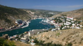 Tilt-shift miniature effect of aerial view of Balaklava bay, Ukraine stock video