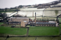 Tilt and shift photo. Graphy technique of an old  mill Royalty Free Stock Image