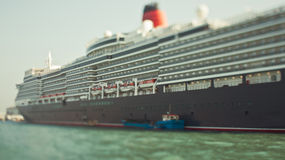 Tilt-shift photo of huge cruise liner Royalty Free Stock Photo