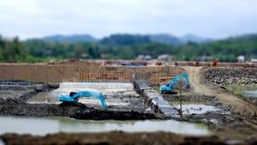 Tilt shift photo about blue excavator Stock Photos