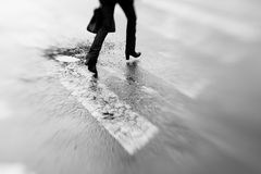 Tilt and shift photo of a cracked crossroad with feet running on Royalty Free Stock Images
