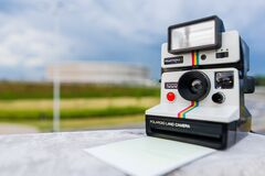 Tilt Shift Photography of Polaroid Land Camera on White Table Stock Photo
