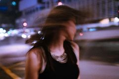 Tilt Shift Photography of Woman Wearing Tank Top during Nighttime Royalty Free Stock Photography