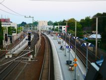 Tilt shift picture of a railroad platform with signal lights stock images
