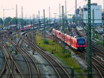 Tilt shift picture of train leaving a railway station royalty free stock photo