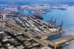 Tilt shift of shipping port with containers and loading transport ship with cargo. In a industry area royalty free stock images