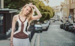 Tilt-shift shooting blonde lady on street Royalty Free Stock Photo